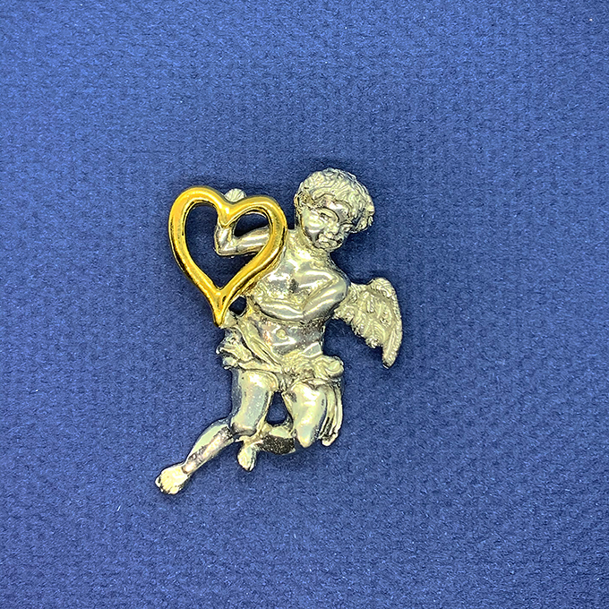 angle with gold Heart Pin